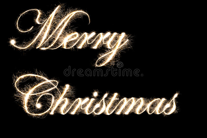 Merry Christmas text by sparkler style. With freeze light stock photo