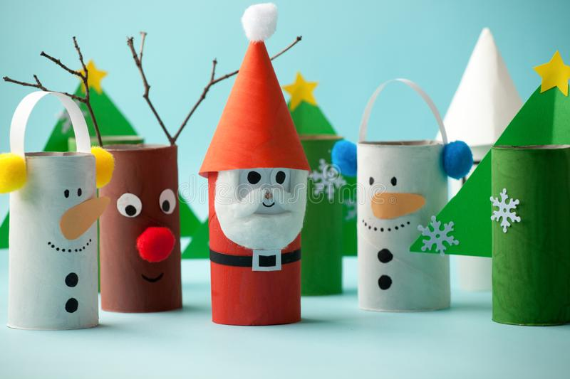 Merry christmas toy collection santa claus, snowman, tree on blue for Winter holiday concept background. Paper crafts, DIY. Creative idea from toilet roll tube royalty free stock image