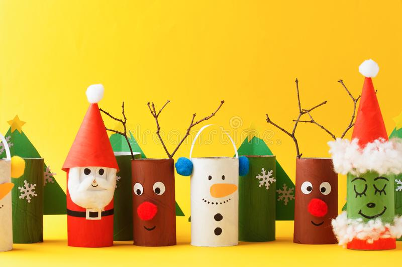 Merry christmas toy collection santa claus, snowman, tree, reindeer on yellow for Winter holiday concept background. Paper crafts stock photo
