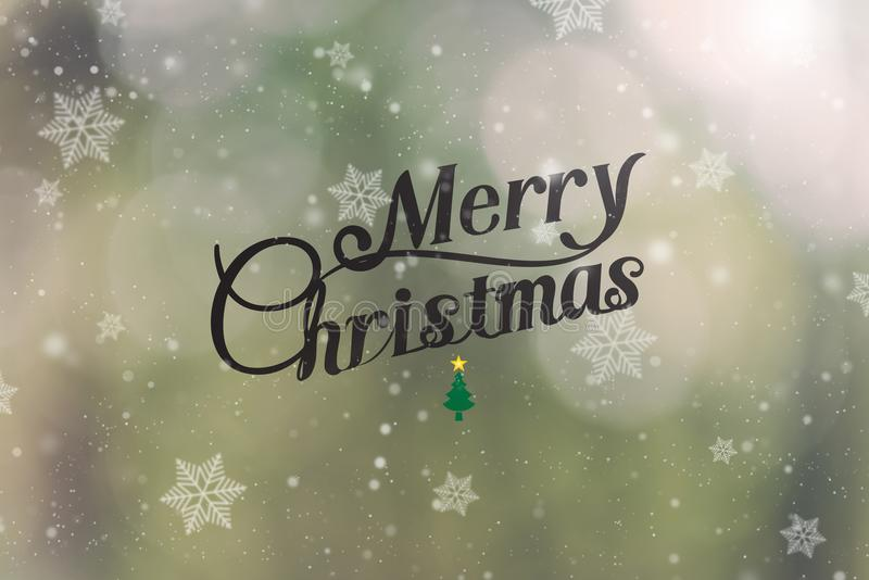 Merry Christmas typographical with snowflake on green bokeh. Background. for Happy New Year 2018 royalty free stock photography