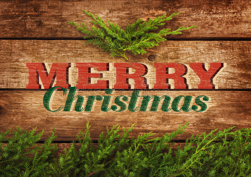 Merry Christmas vintage postcard or poster design. Old planked wood board with pine tree branch stock photo