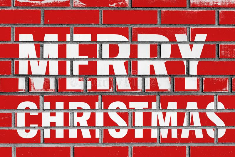 Merry Christmas greeting text on red bricks wall royalty free stock photos