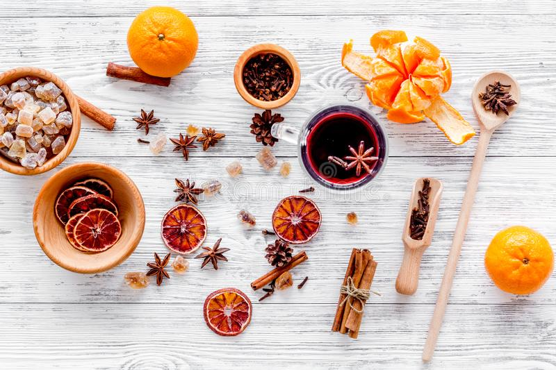 Merry christmas in winter evening with warm drink. Hot mulled wine or grog with fruits and spices on light background. Merry christmas in winter evening with stock photo