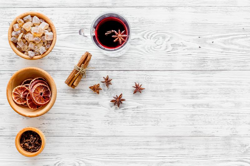 Merry christmas in winter evening with warm drink. Hot mulled wine or grog with fruits and spices on light background. Merry christmas in winter evening with stock images