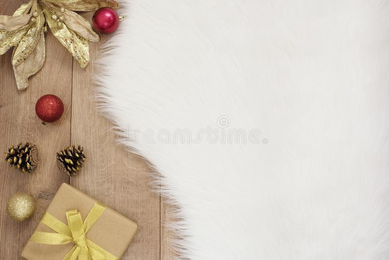 Merry Christmas. Winter Holidays Concept - cozy home, balls, gift, cones. Golden theme. Merry Christmas. Winter Holidays Concept - cozy home, balls, gift, cone stock image