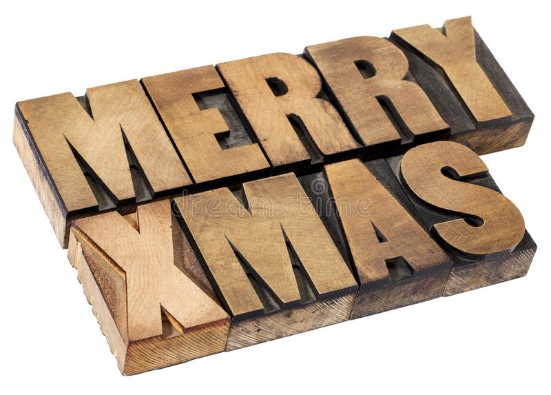 Merry Christmas in wood type. Merry Christmas (Xmas) - isolated text in vintage letterpress wood type stock photos