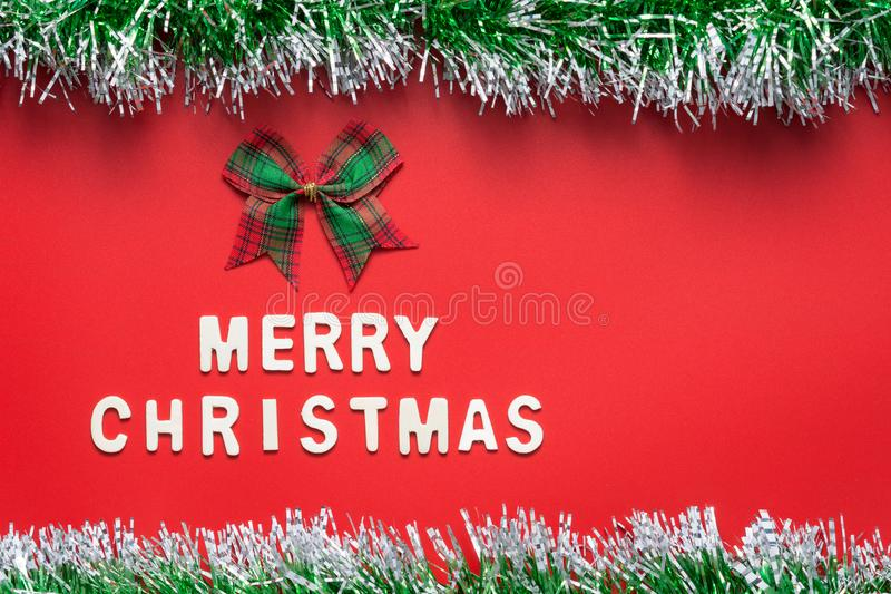 Download MERRY CHRISTMAS Words And Ribbon Bow With Glitter Frame On Red Background Stock Photo - Image of celebration, decoration: 100036488
