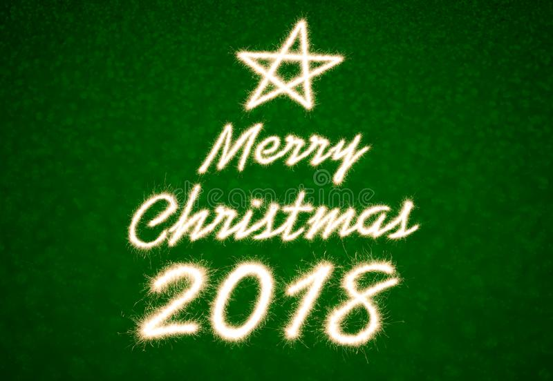 Merry christmas 2018. Written with Sparkle firework over bokeh light royalty free stock photography