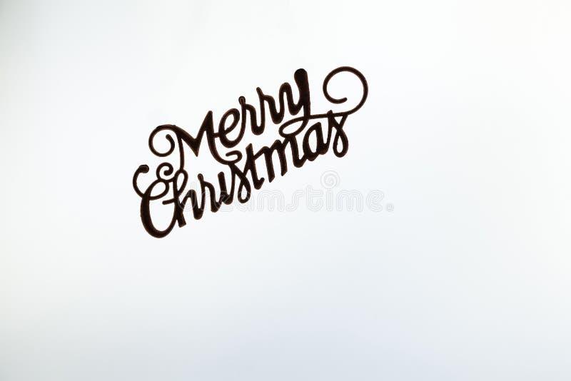 Merry Christmas written on white. Background royalty free stock photo