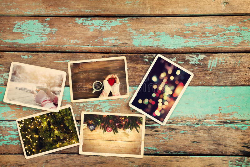 Merry christmas xmas photo album on old wood table. Paper photo of camera - vintage and retro style royalty free stock photography