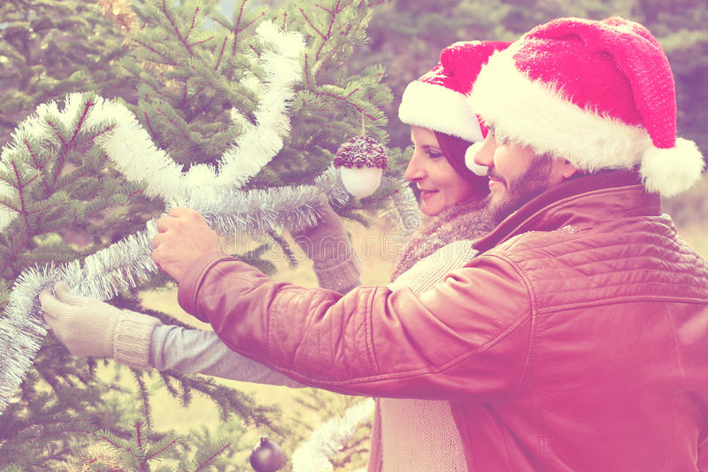 Merry Christmas. Young couple celebrating Christmas outdoor. Young couple celebrating Christmas outdoor stock photography