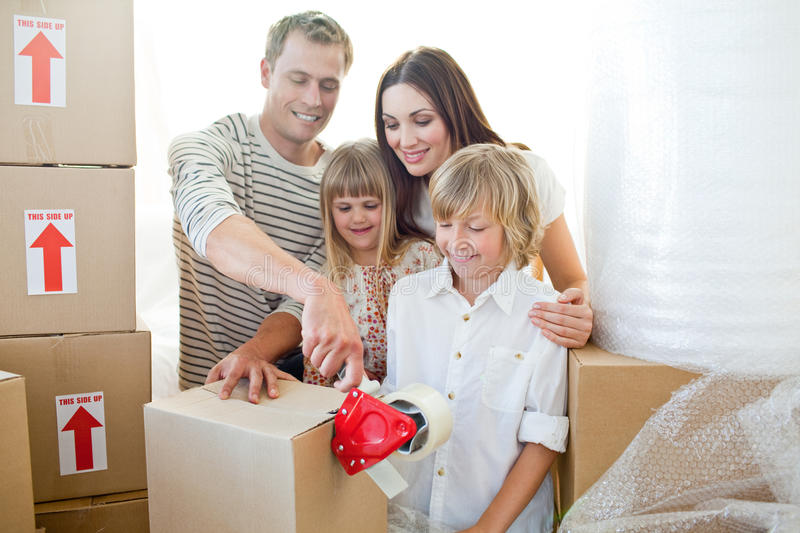 Merry family packing boxes stock photography