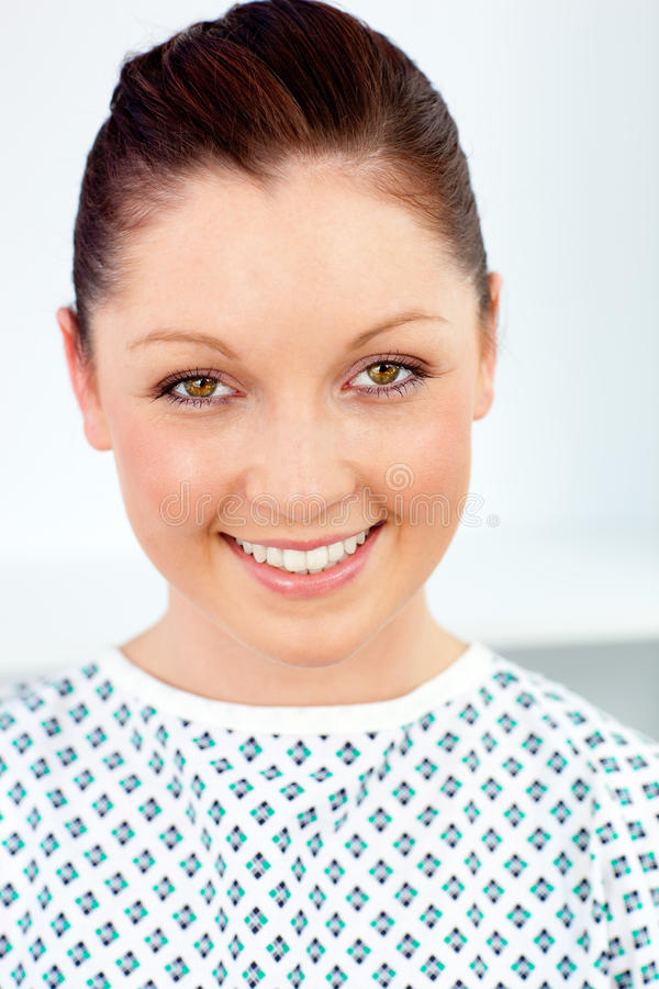 Merry female patient smiling at the camera. Portrait of a merry female patient smiling at the camera against a white background royalty free stock photo
