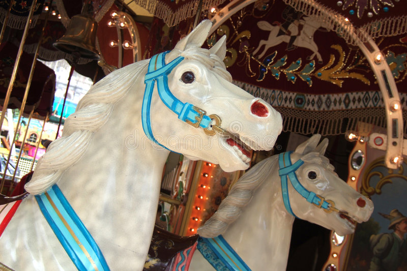 Merry-go-round. Two horses in a merry go round at a fair stock image