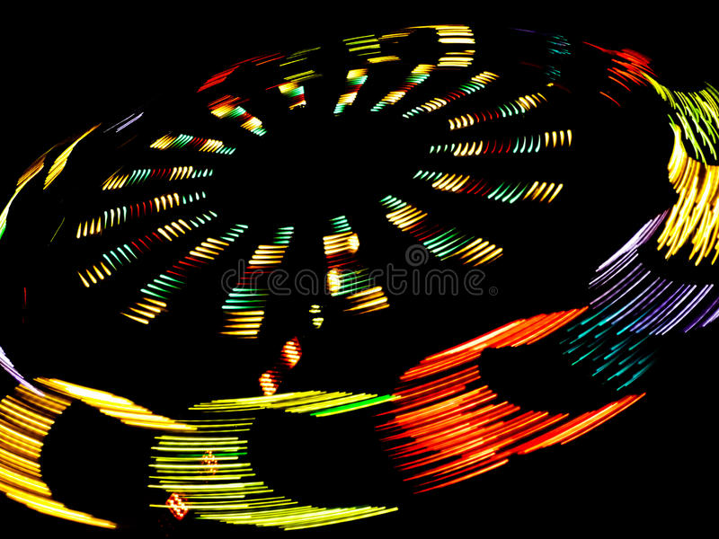 Merry-go-round. A night view of a merry-go-round with long exposition royalty free stock photo
