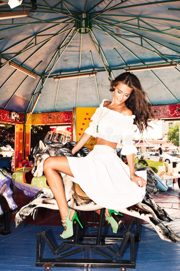 Download Merry go round stock photo. Image of ride, brunette, full - 26049752