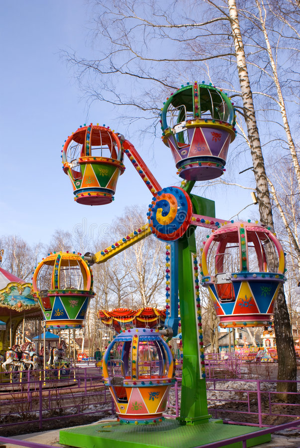 Merry-go-round. Colorful merry-go-round baskets of turning wheel royalty free stock photo
