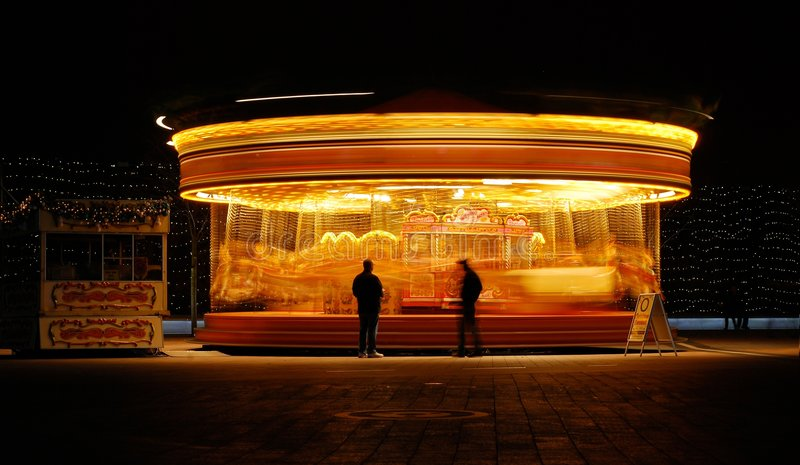 Merry go round. At night stock images