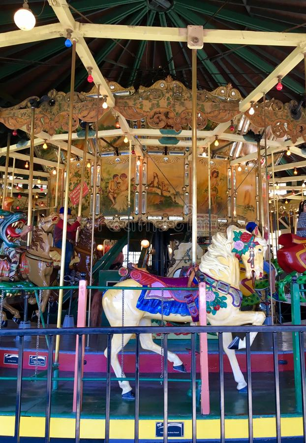 Merry-go-Round Ride. This merry-go-round, built in 1889, is beautifully crafted and fun for all ages to ride stock photos