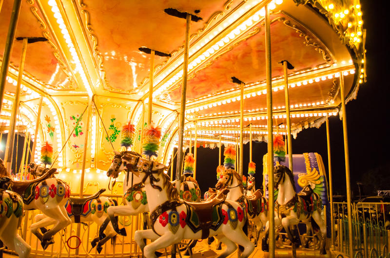 Merry-go-round at canival at night stock photo