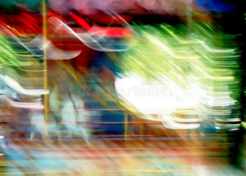 Merry-go-round, carousel ride attraction motion in blur. Carousel ride attraction motion in blur child on white horse royalty free stock photo