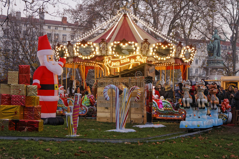 Merry-go-round of Christmas Market. LYON, FRANCE, December 17, 2016 : The Christmas market of Lyon, a village of more than 130 chalets on the Place Carnot allows stock photo