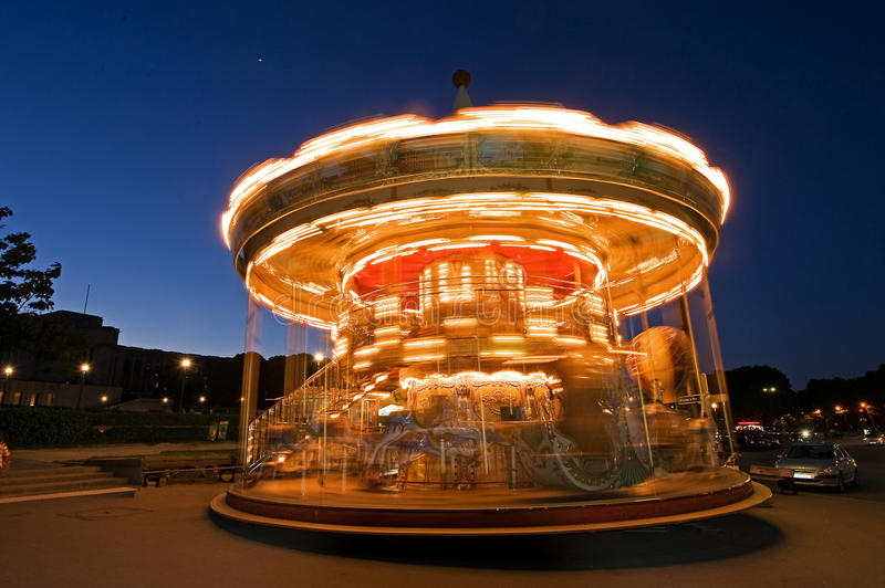 Merry-go-round in Motion. With evening background stock photos