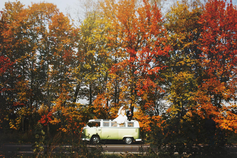Merry happy young couple on the background fabulous autumn fores stock photo