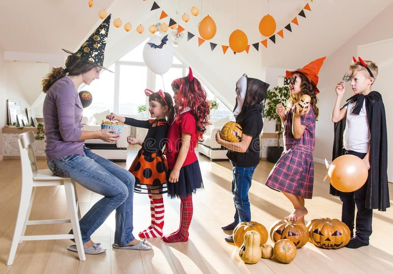Kids in Halloween party. Merry kids ask for a treat for a Halloween party stock image