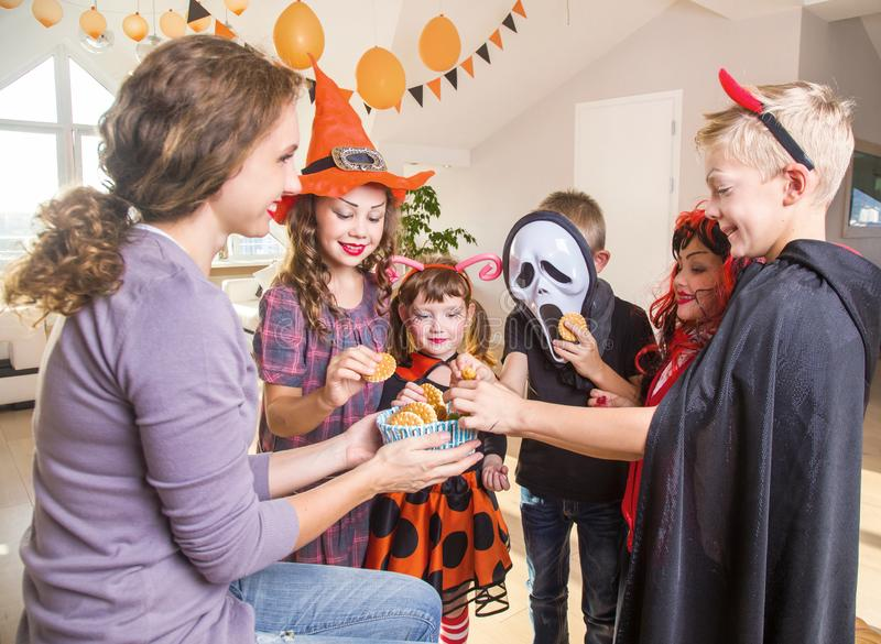 Kids in Halloween party. Merry kids ask for a treat for a Halloween party royalty free stock image