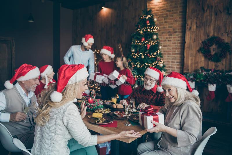 Merry x-mas family gathering of young people small little boy kids son mature pensioners sit table with newyear feast. Merry x-mas family gathering of young stock images