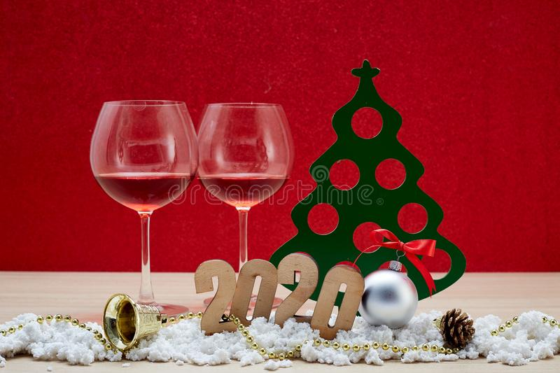 Merry New Year 2020 Christmas with celebration decorations. Red background, minimal copy space for text royalty free stock photo