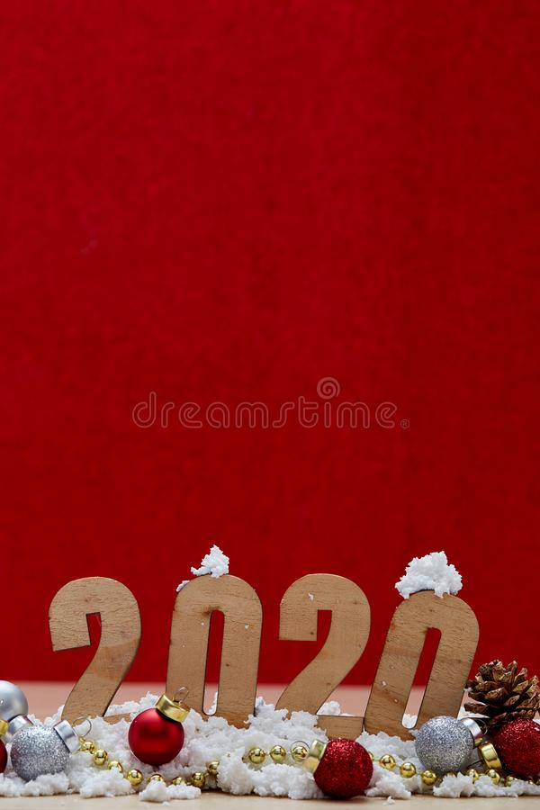 Merry New Year 2020 Christmas with celebration decorations. Red background, minimal copy space for text royalty free stock images
