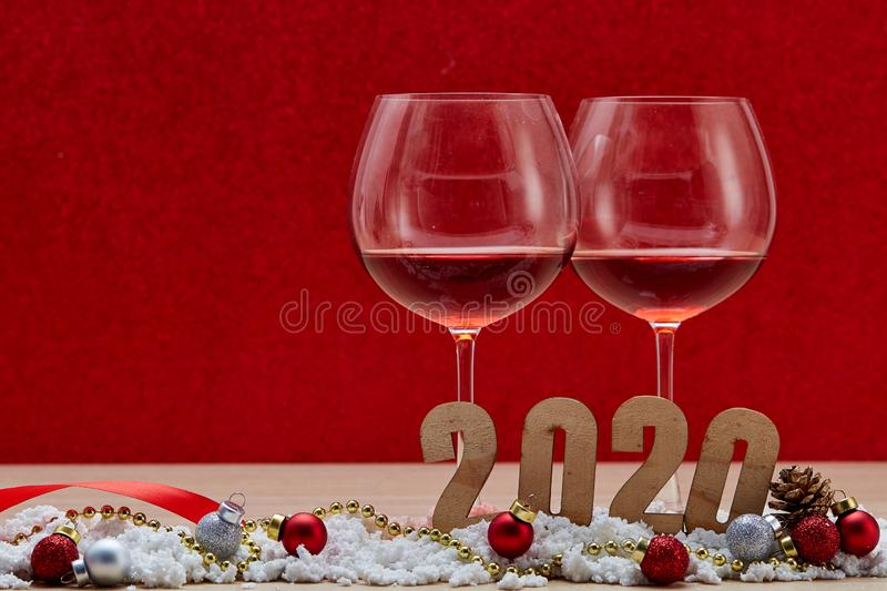 Merry New Year 2020 Christmas with celebration decorations. Red background, minimal copy space for text stock photography