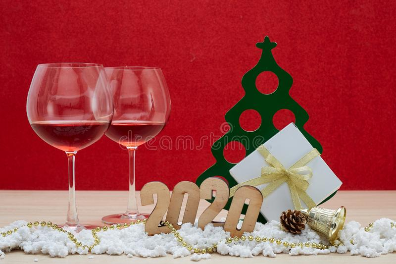 Merry New Year 2020 Christmas with celebration decorations. Red background, minimal copy space for text stock photo