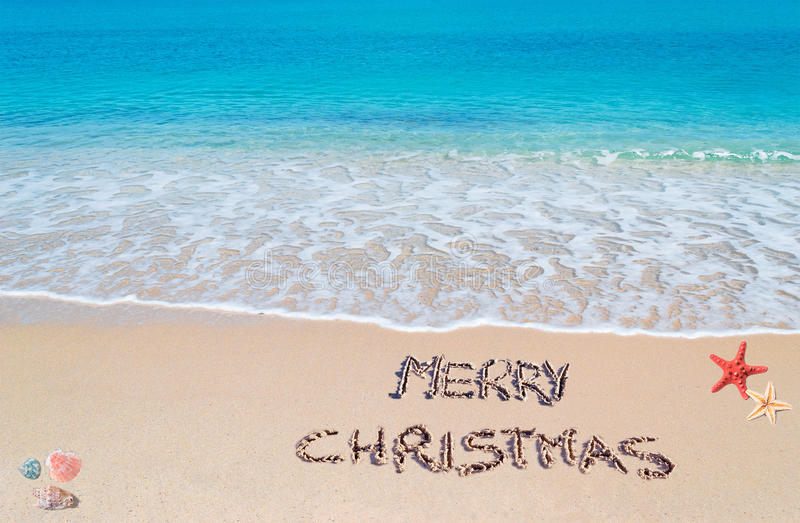 Merry sandy Christmas. Merry christmas written on a tropical beach royalty free stock image