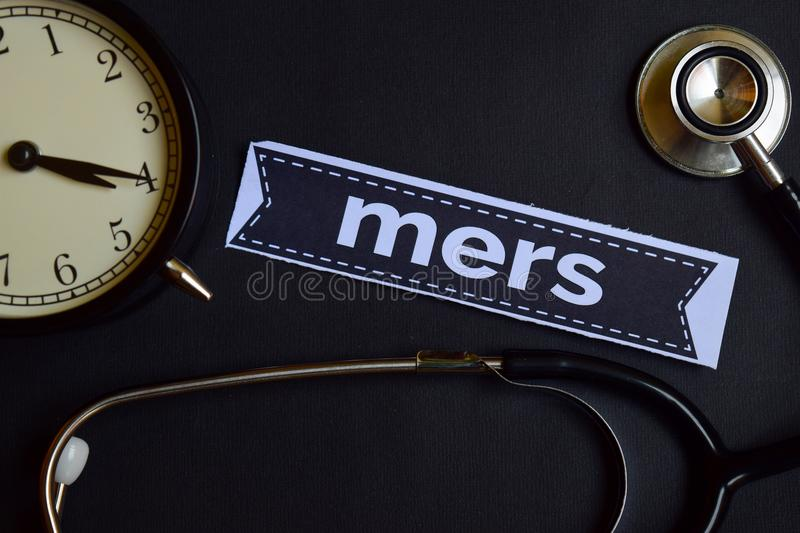 Mers on the print paper with Healthcare Concept Inspiration. alarm clock, Black stethoscope. royalty free stock photos