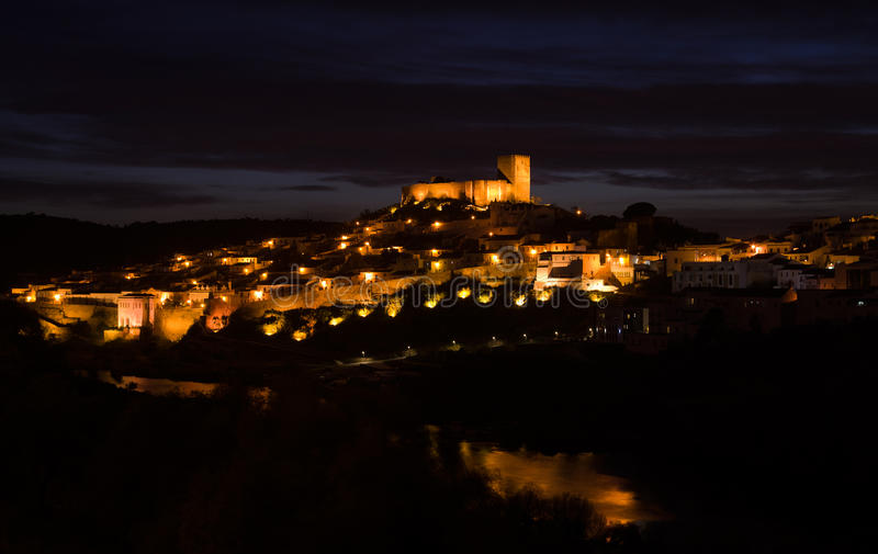 Mertola castle, town and river at night royalty free stock photography
