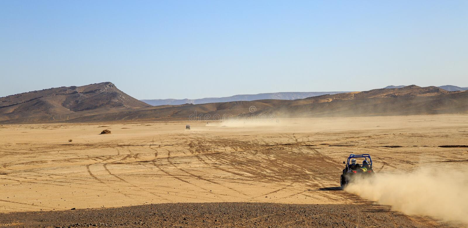 Merzouga, Morocco - Feb 25, 2016: panoramic view on convoys of offroad cars in Morocco desert near Merzouga. Merzouga is famous. For its dunes, the highest in stock photos