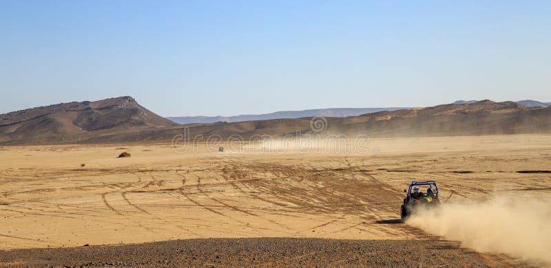 Merzouga, Morocco - Feb 25, 2016: panoramic view on convoys of offroad cars in Morocco desert near Merzouga. Merzouga is famous stock photos