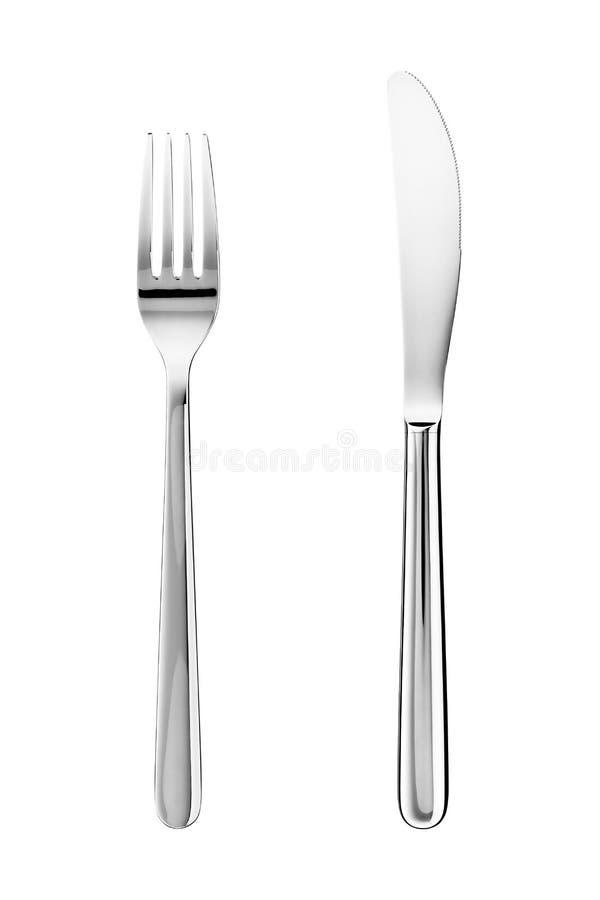 Mes en vork die op wit wordt geïsoleerd royalty-vrije stock foto