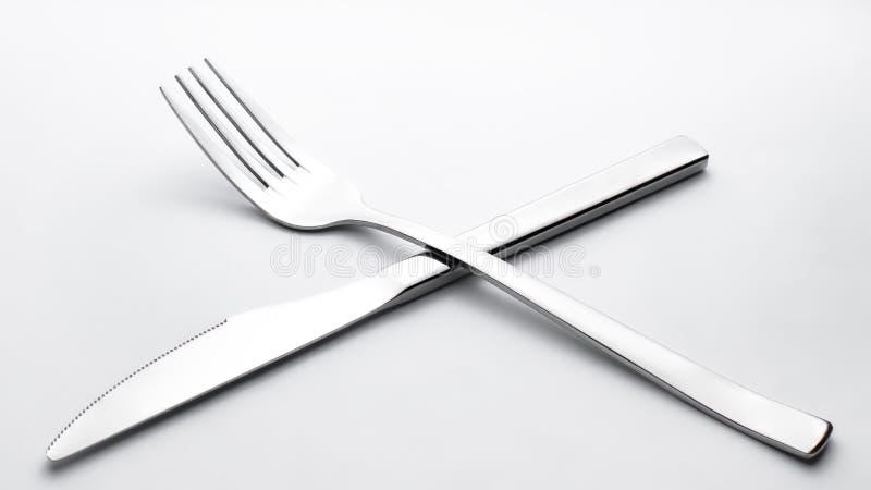 Mes en vork op witte achtergrond royalty-vrije stock afbeelding