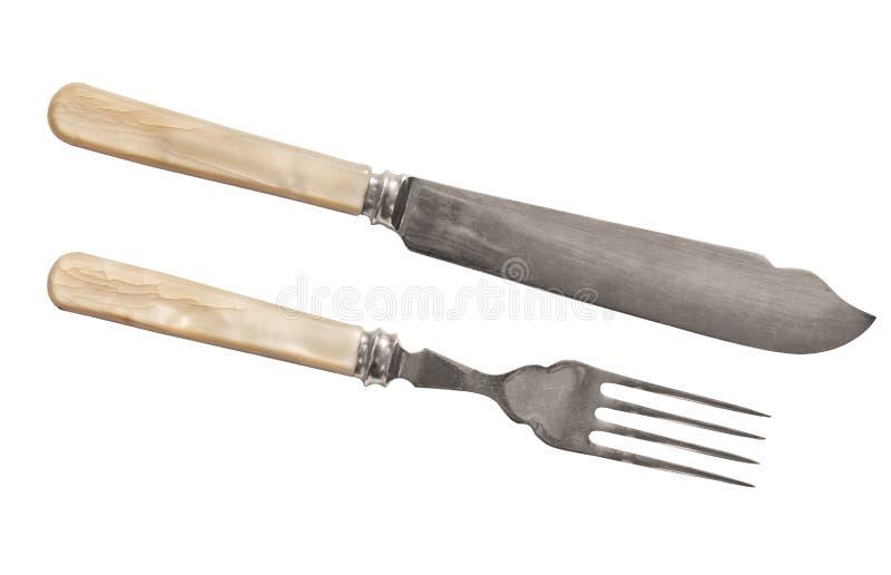 Mes en vork op witte achtergrond wordt geïsoleerd die royalty-vrije stock afbeeldingen