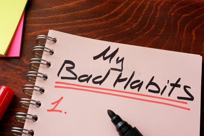 Mes mauvaises habitudes écrites sur un bloc-notes images libres de droits