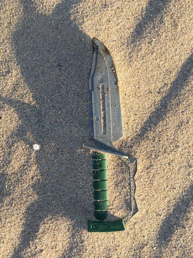 Mes in zand stock foto