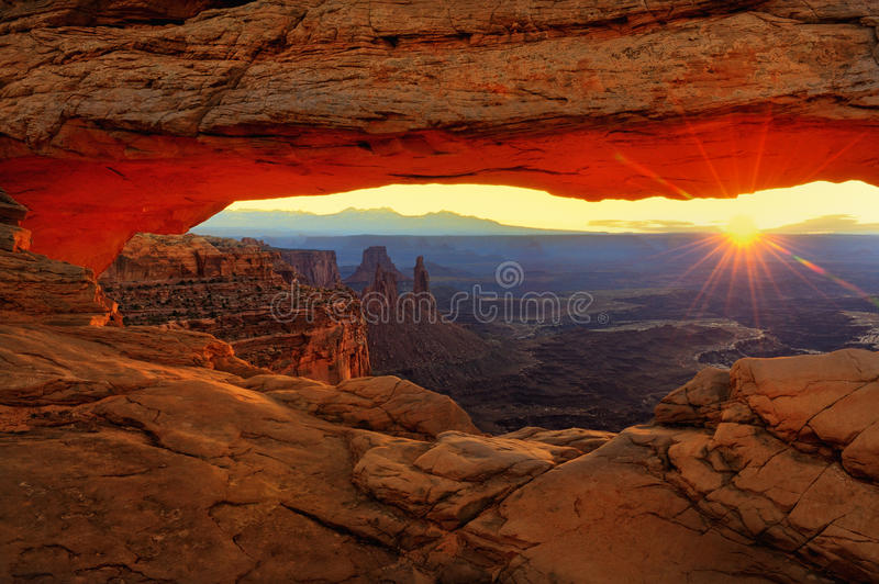 Mesa Arch. Sunburst at sunrise through the Mesa Arch in Canyonlands National Park near Moab, Utah stock photos