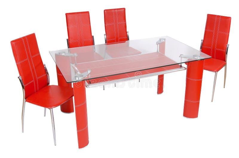 Mesa de jantar e cadeiras de vidro foto de stock