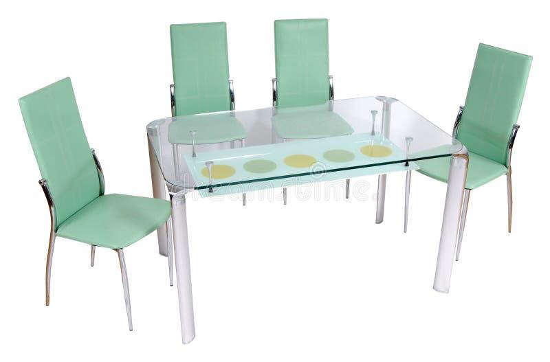Mesa de jantar e cadeiras de vidro imagens de stock