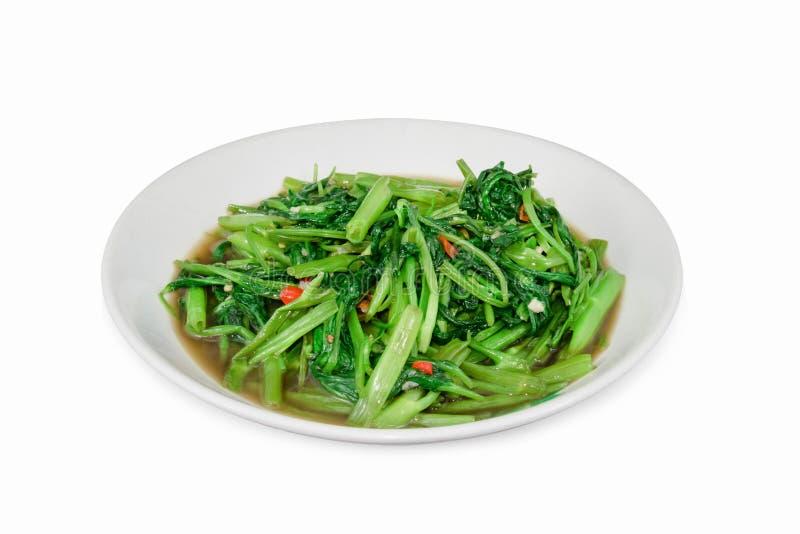 Mescoli il daeng di fai del boong di Pak o di Fried Water Spinach isolato su briciolo immagini stock libere da diritti