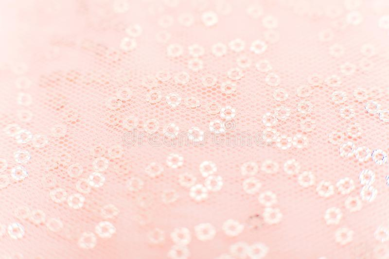 Mesh fabric texture with sequins Texture cloth mesh. Pink shiny mesh fabric close-up. Beautiful and original background or texture royalty free stock images